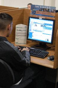 Photo of a man using a computer.